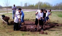 Students tend garden bed