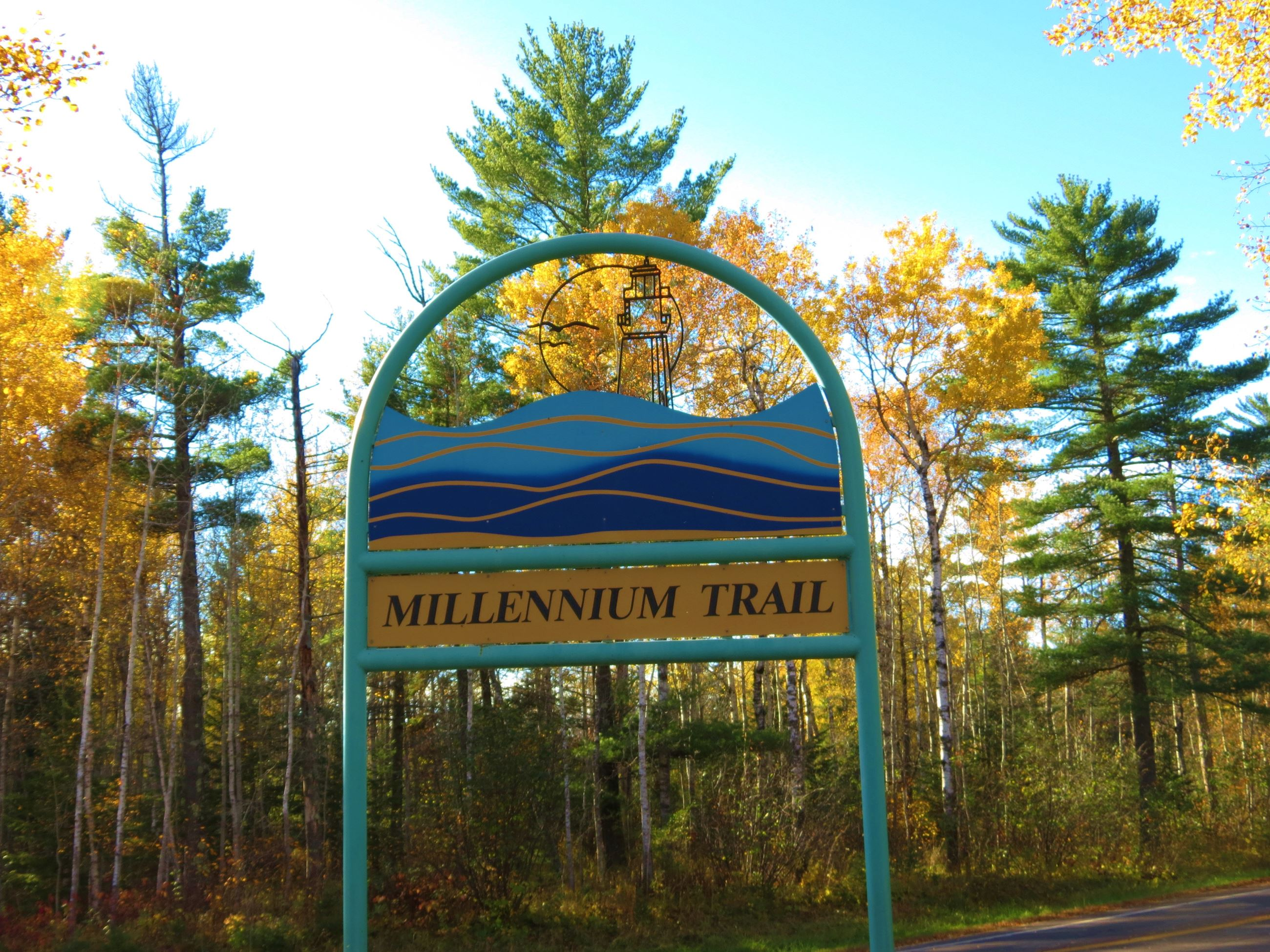 Millennium Trail sign with autumn leaves