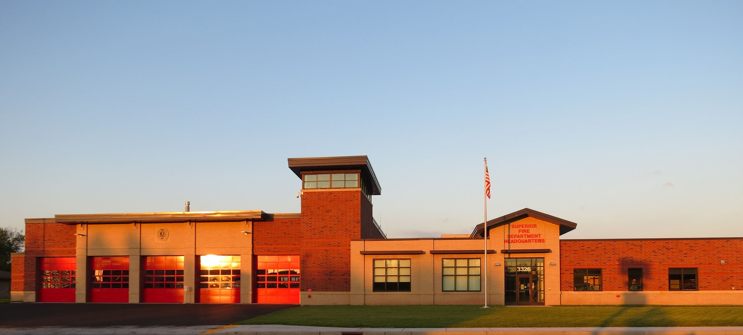 Superior Fire Department Headquarters with the sun setting on the building