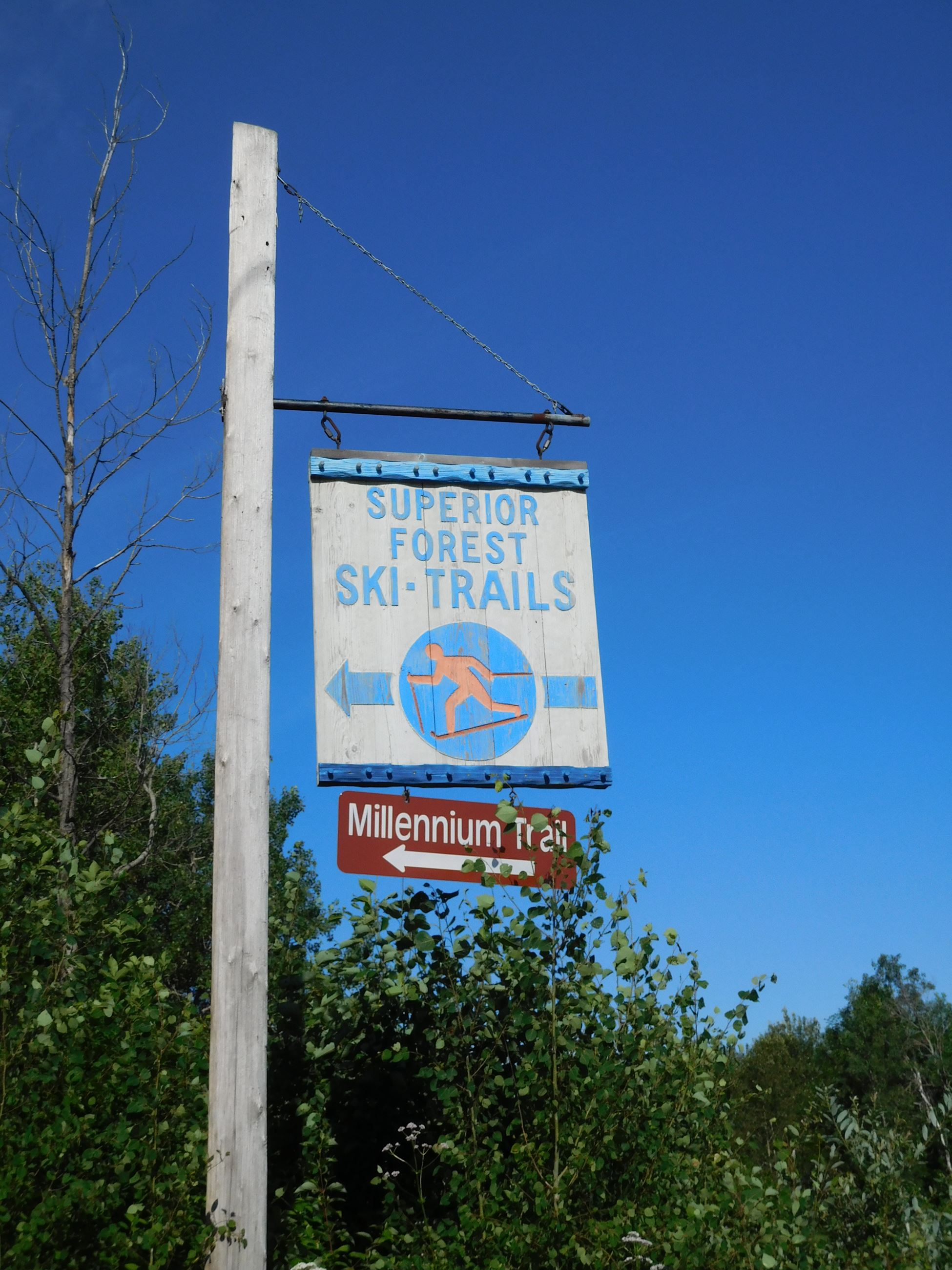 Sign at entrance to Millennium Trail head parking lot noting Municipal Forest Ski Trails and Millennium Trail